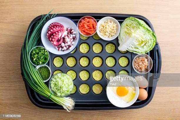 octopus grill recipe. on the iron plate, materials such as octopus, leeks, eggs, flour, cabbage, and bonito are placed.angle shot from above. - tenkasu stock pictures, royalty-free photos & images