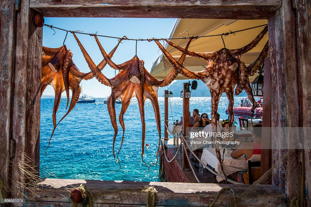 Octopus hanging at Ammoudi bay : Stock Photo