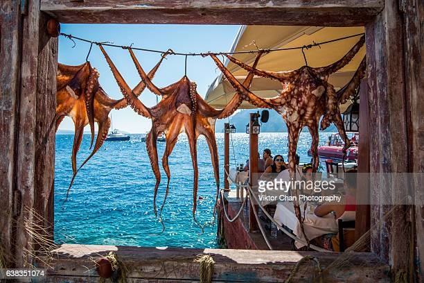 octopus hanging at ammoudi bay - greece stock pictures, royalty-free photos & images