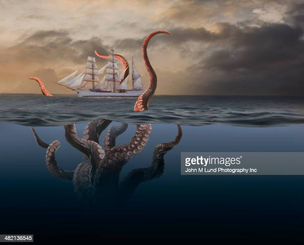 Octopus tentacles attacking ship