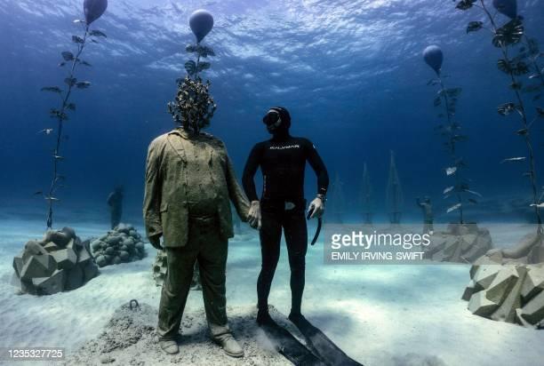 OCypriot freediver Angels Savvas poses with a sculpture in the MUSAM underwater sculpture park, billed as the worlds first underwater forest,...