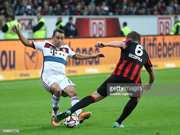 Oczipka of Eintracht Frankfurt in action against Rafinha of Bayern München during the Bundesliga soccer match between Eintracht Frankfurt and Bayern...