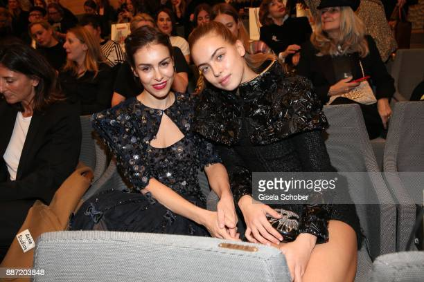 Oda Jaune and her daughter Ida Jaune of Joerg Immendorff during the Chanel 'Trombinoscope' Collection des Metiers d'Art 2017/18 photo call at...