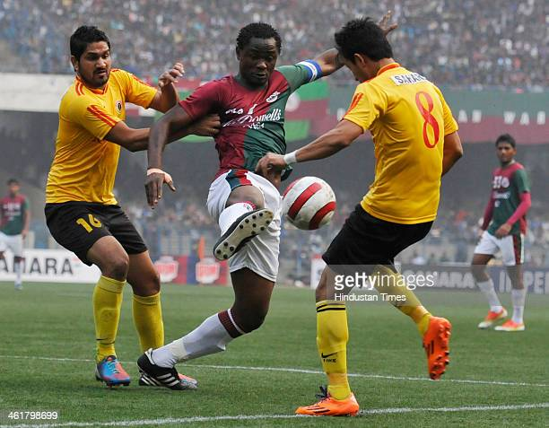 Odafa Okolie of Mohunbagan is being blocked by Gurwinder Singh and Naoba Sing of East Bengal during the Premier Division League Derby Match at Yuba...