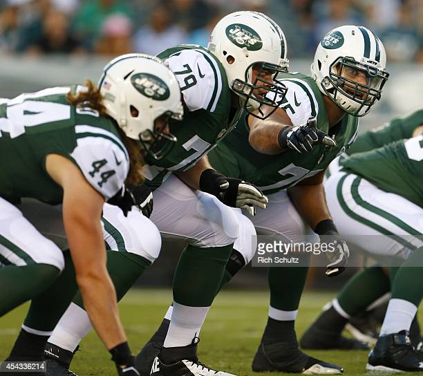 Oday Aboushi Brent Qvale and Zach Sudfeld of the New York Jets line up on the offensive line during a preseason football game against the...
