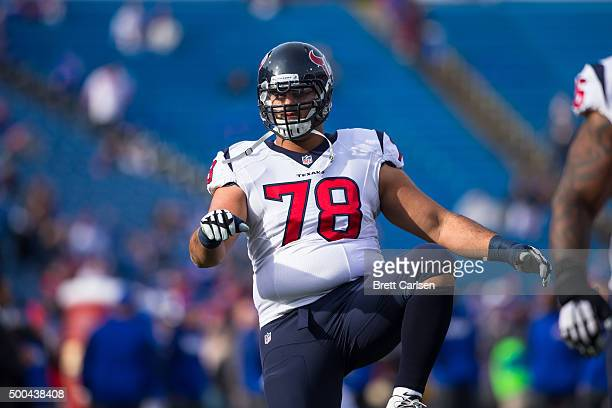 Oday Aboushi of the Houston Texans warms up with teammates before the game against the Buffalo Bills on December 6 2015 at Ralph Wilson Stadium in...
