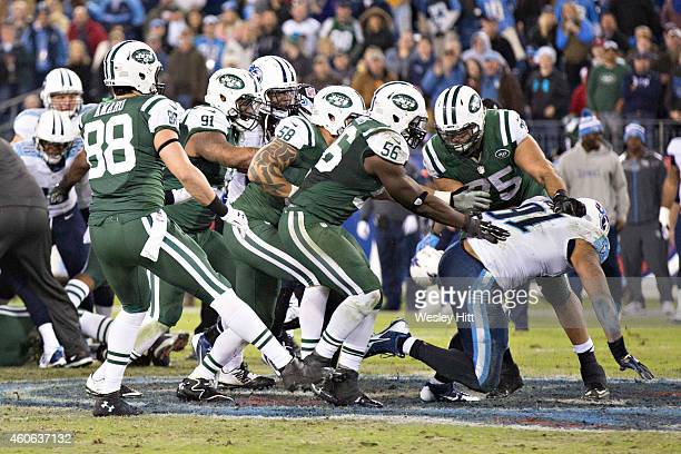 Oday Aboushi of the New York Jets in a fight with Derrick Morgan of the Tennessee Titans in the third quarter at LP Field on December 14 2014 in...