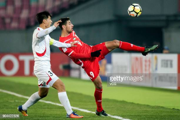Oday Dabbagh of Palestine kicks the ball during the AFC U23 Championship Group B match between Palestine and North Korea at Jiangyin Stadium on...