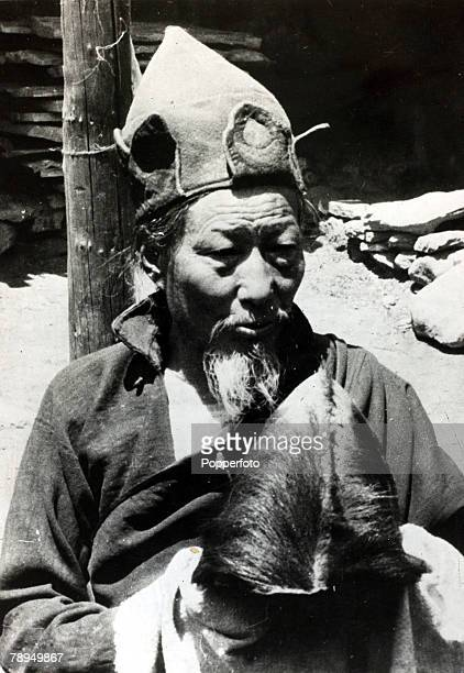 Oddities Mythical Creatures Abominable Snowman pic circa 1960 A Tibetan man holding the Pangboche scalp at the Pangboche Monastery