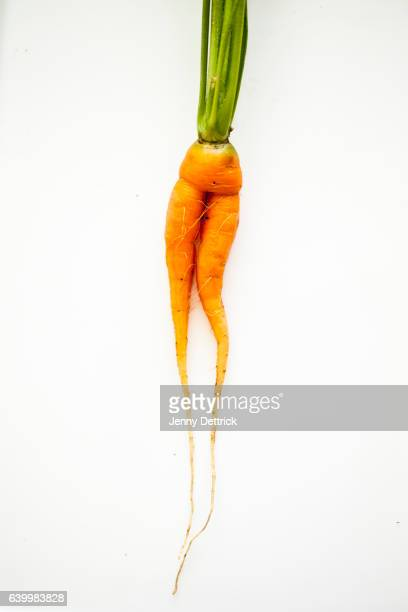 odd-shaped carrot - pareidolia stock pictures, royalty-free photos & images