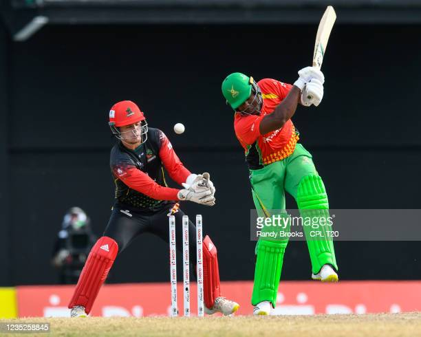 Odean Smith of Guyana Amazon Warriors bowled by Fawad Ahmed as Joshua de Silva of Saint Kitts & Nevis Patriots watch during the 2021 Hero Caribbean...