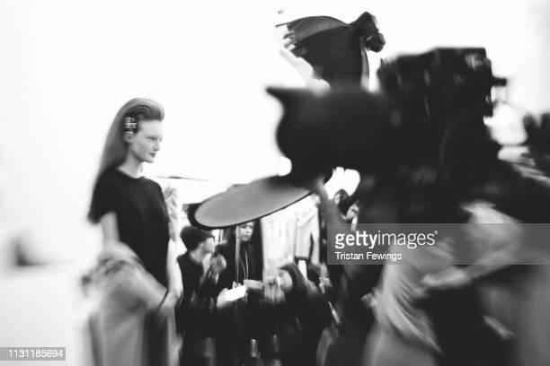 A odel poses backstage ahead of the Vivetta show at Milan Fashion Week Autumn/Winter 2019/20 on February 21 2019 in Milan Italy