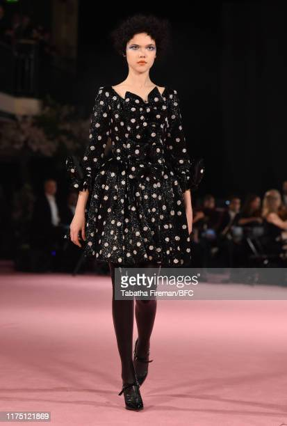 Odel walks the runway at the Richard Quinn show during London Fashion Week September 2019 at York Hall on September 16, 2019 in London, England.