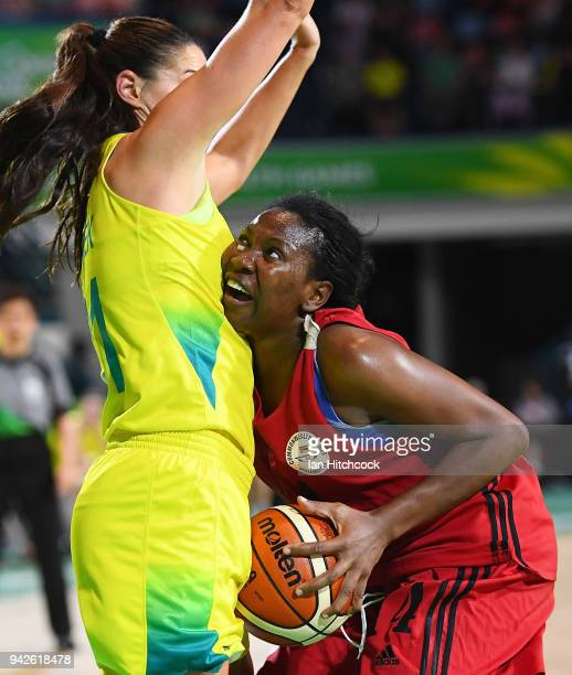 Odelia Mafanela of Mozambique collides with Alice Kunek of Australia l during the womenÕs Pool A Basketball match between Australia and Mozambique on...