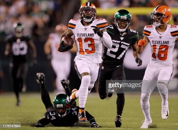 Odell Beckham Jr #13 of the Cleveland Browns breaks free from Brian Poole and Darryl Roberts of the New York Jets to run the ball 89 yards in for the...