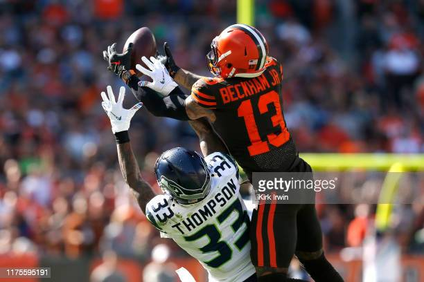 Odell Beckham Jr #13 of the Cleveland Browns catches a pass over the defense of Tedric Thompson of the Seattle Seahawks during the second quarter at...