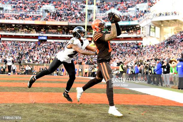 Odell Beckham Jr. #13 of the Cleveland Browns catches a touchdown pass against Marcus Peters of the Baltimore Ravens during the fourth quarter in the...