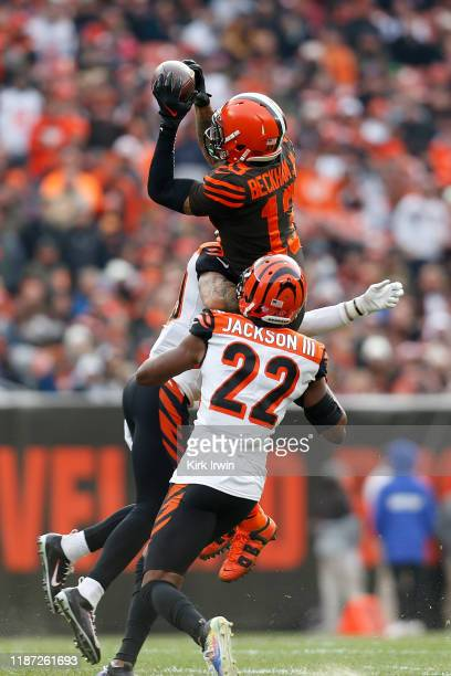 Odell Beckham Jr. #13 of the Cleveland Browns is unable to complete the catch while being hit by Jessie Bates III of the Cincinnati Bengals and...