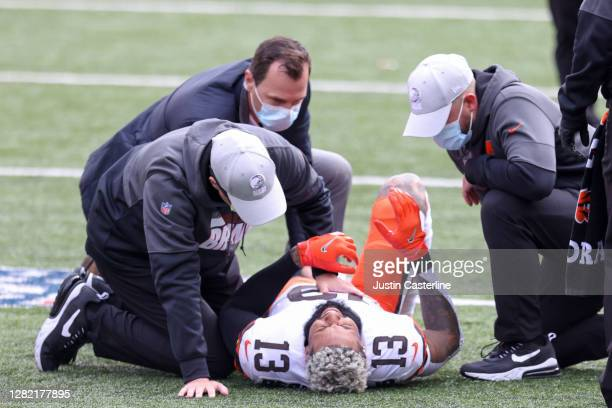 Odell Beckham Jr. #13 of the Cleveland Browns lays on the field with an injury in the game against the Cincinnati Bengals during the first quarter at...