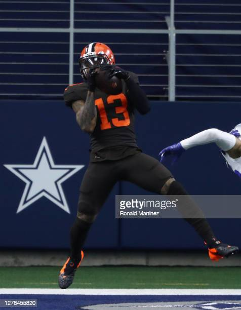 Odell Beckham Jr. #13 of the Cleveland Browns makes a touchdown pass reception against the Dallas Cowboys in the first quarter at AT&T Stadium on...