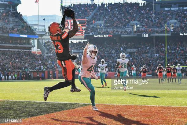 Odell Beckham Jr. #13 of the Cleveland Browns pulls in a 35-yard touchdown catch in the first quarter as Nik Needham of the Miami Dolphins defends at...