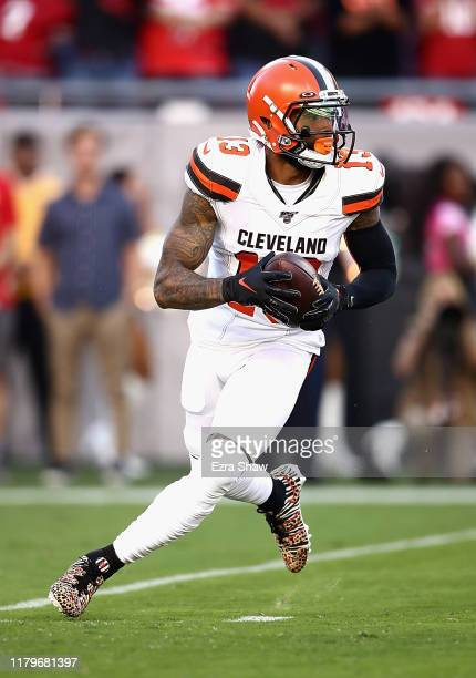 Odell Beckham Jr. #13 of the Cleveland Browns scrambles to pass against the San Francisco 49ers in the first quarter at Levi's Stadium on October 07,...