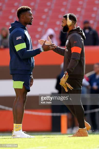 Odell Beckham Jr #13 of the Cleveland Browns shakes hands with DK Metcalf of the Seattle Seahawks prior to the start of the game at FirstEnergy...