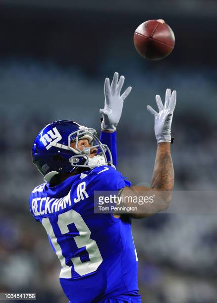 Odell Beckham Jr #13 of the New York Giants catches a pass during warm ups before the game against the Dallas Cowboys at ATT Stadium on September 16...