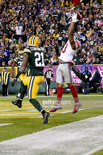 Odell Beckham Jr #13 of the New York Giants catches a pass for a touchdown in front of Ha Ha ClintonDix of the Green Bay Packers during the second...
