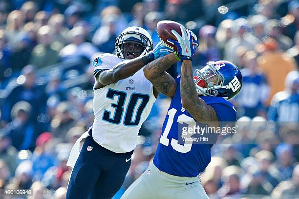 Odell Beckham Jr #13 of the New York Giants catches a pass in the first half while being defended by Jason McCourty of the Tennessee Titans at LP...