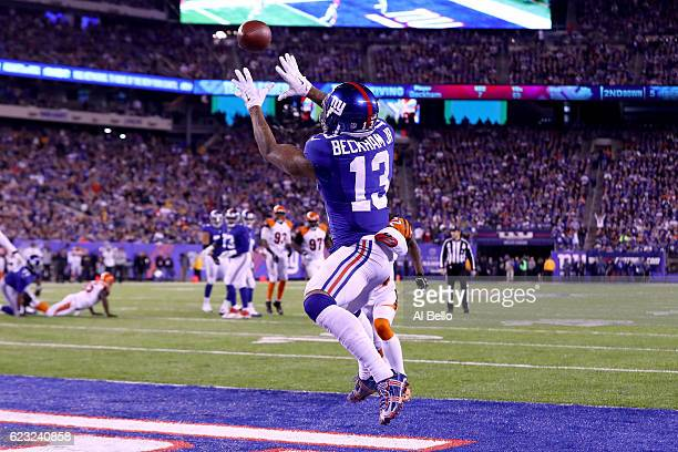 Odell Beckham Jr #13 of the New York Giants catches a touchdown pass against the Cincinnati Bengals during the second quarter of the game at MetLife...