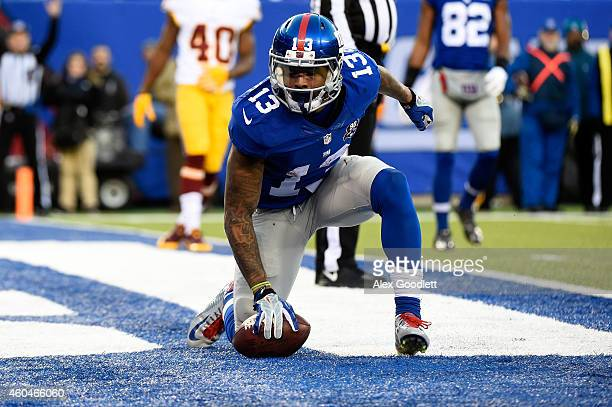 Odell Beckham Jr #13 of the New York Giants celebrates after scoring a 6 yard touchdown in the fourth quarter against the Washington Redskins during...