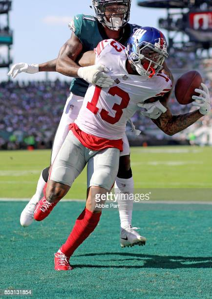 Odell Beckham Jr #13 of the New York Giants completes a four yard touchdown catch against Jalen Mills of the Philadelphia Eagles in the third quarter...