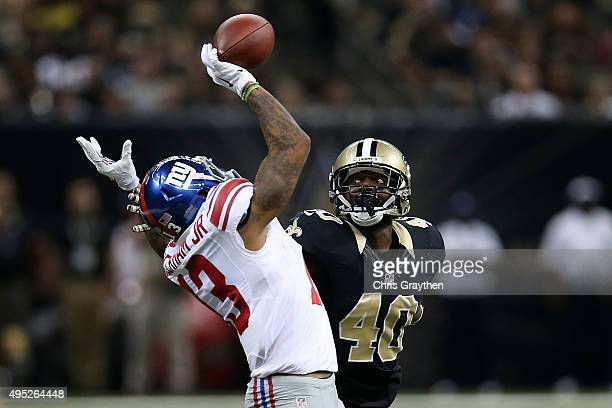 Odell Beckham Jr #13 of the New York Giants is unable to catch a ball while being defended by Delvin Breaux of the New Orleans Saints during a game...