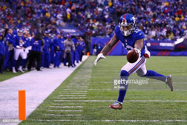 Odell Beckham Jr #13 of the New York Giants makes a catch to carry the ball 4yards for a touchdown against the Detroit Lions in the fourth quarter at...