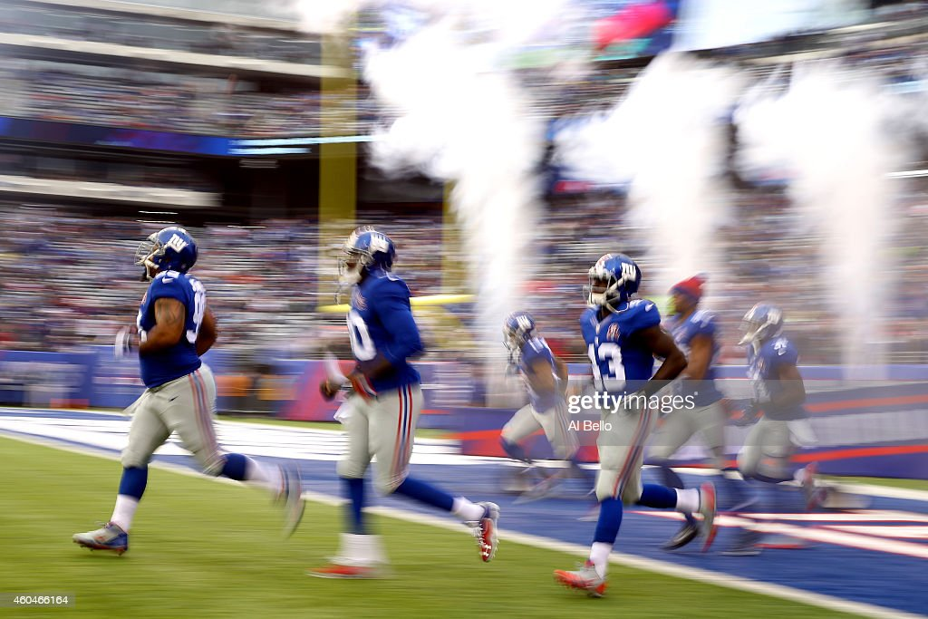 Odell Beckham Jr. #13 of the New York Giants runs on the field with his teammates prior to the start of their game against the Washington Redskins at MetLife Stadium on December 14, 2014 in East Rutherford, New Jersey.