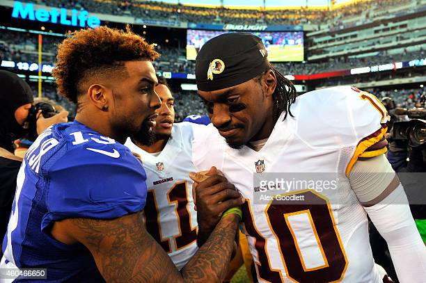 Odell Beckham Jr #13 of the New York Giants shakes hands with Robert Griffin III of the Washington Redskins after their game at MetLife Stadium on...