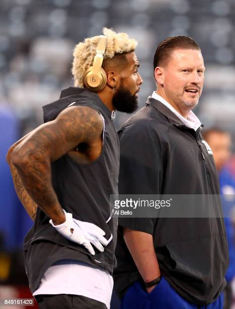 Odell Beckham Jr #13 of the New York Giants talks with head coach Ben McAdoo prior to their game against the Detroit Lions at MetLife Stadium on...