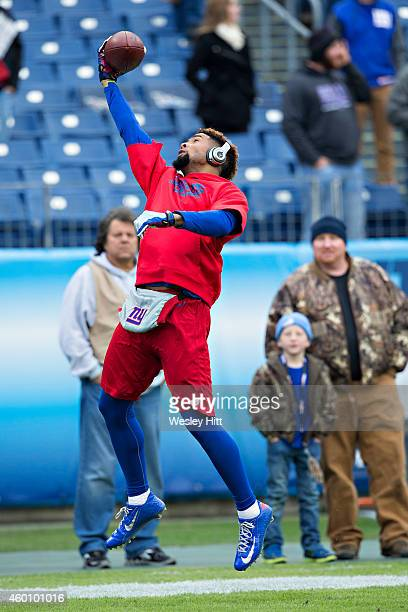 Odell Beckham Jr #13 of the New York Giants warming up with one handed catches in the end zone in front of fans before a game against the Tennessee...