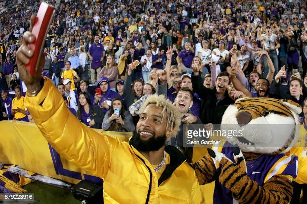 Odell Beckham Jr of the New York Giants takes a picture with Mike the Tiger during the second half of a game between the LSU Tigers and the Texas AM...