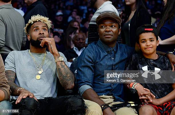 Odell Beckham Jr wide receiver for the New York Giants seated court side next to actor David Oyelowo and his son Caleb the basketball game between...