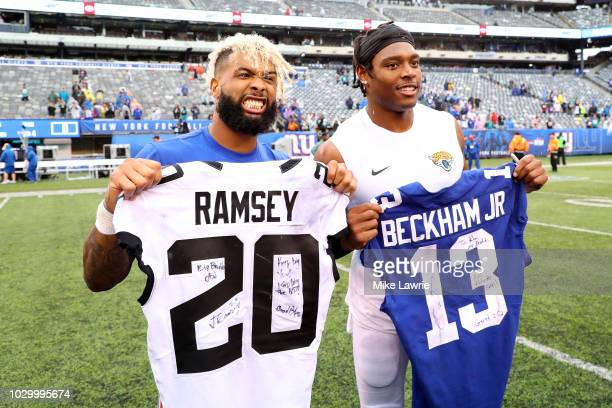 Odell Beckham Jr#13 of the New York Giants and Jalen Ramsey of the Jacksonville Jaguars exchange jerseys after their game at MetLife Stadium on...