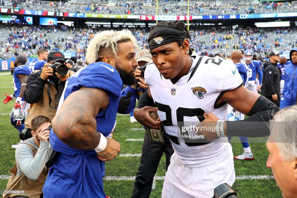 Odell Beckham Jr.#13 of the New York Giants and Jalen Ramsey #20 of the Jacksonville Jaguars exchange jerseys after their game at MetLife Stadium on September 9, 2018 in East Rutherford, New Jersey. The Jaguars defeated the Giants 20-15.