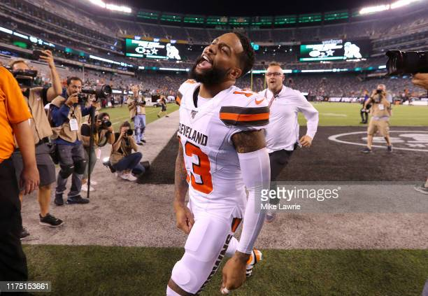 Odell Beckham of the Cleveland Browns runs off the field after defeating the New York Jets at MetLife Stadium on September 16 2019 in East Rutherford...