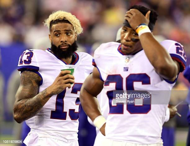 Odell Beckham of the New York Giants and Saquon Barkley of the New York Giants on the sidelines during a game against the Philadelphia Eagles at...