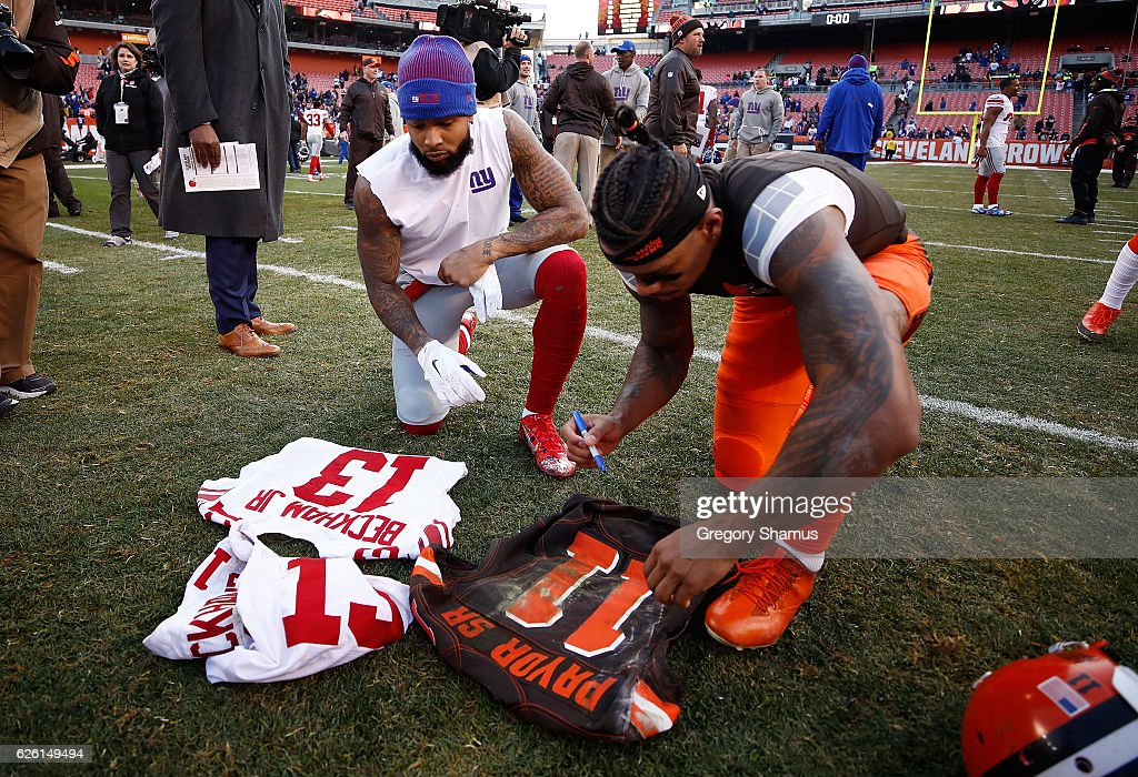 Odell Beckham #13 of the New York Giants and Terrelle Pryor #11 of the Cleveland Browns sign jerseys after New York won the game 27-13 at FirstEnergy Stadium on November 27, 2016 in Cleveland, Ohio.