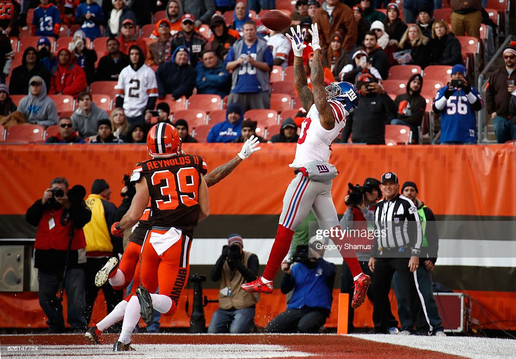 Odell Beckham #13 of the New York Giants can't make a catch inbounds in front of the defense of Ed Reynolds II #39 of the Cleveland Browns during the fourth quarter at FirstEnergy Stadium on November 27, 2016 in Cleveland, Ohio.