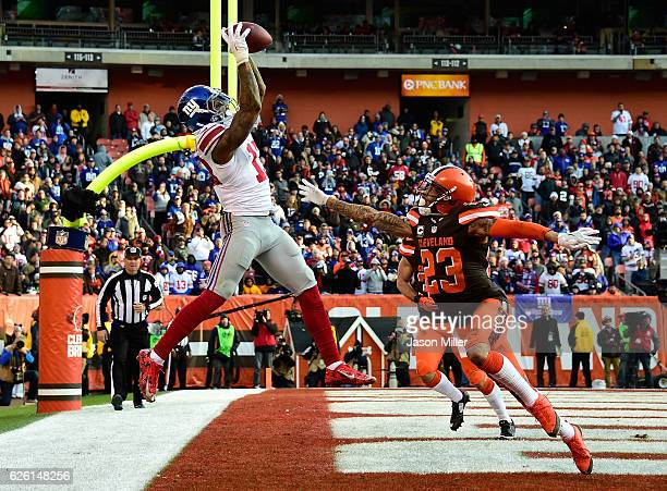 Odell Beckham of the New York Giants can't make a catch inbounds in front of the defense of Joe Haden of the Cleveland Browns during the fourth...
