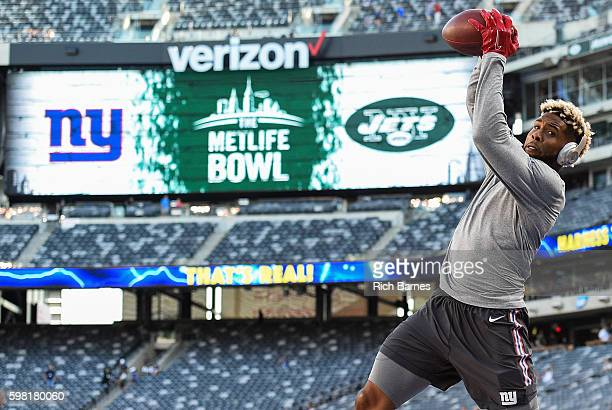 Odell Beckham of the New York Giants catches a pass prior to a preseason game against the New York Jets at MetLife Stadium on August 27 2016 in East...