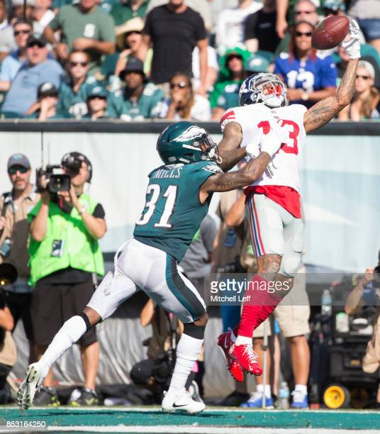 Odell Beckham of the New York Giants catches a touchdown against Jalen Mills of the Philadelphia Eagles in the fourth quarter at Lincoln Financial...